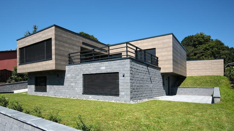 Single family house in Steinen-Lehnacker, Germany cladded with Rockpanel Woods Rhinestone Oak facade cladding