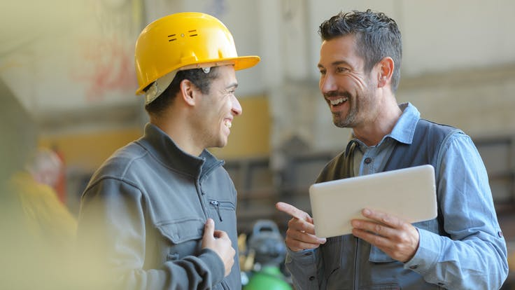 Illustrative image, industry, workers, factory, construction, tablet, hard hat, helmet, laughing