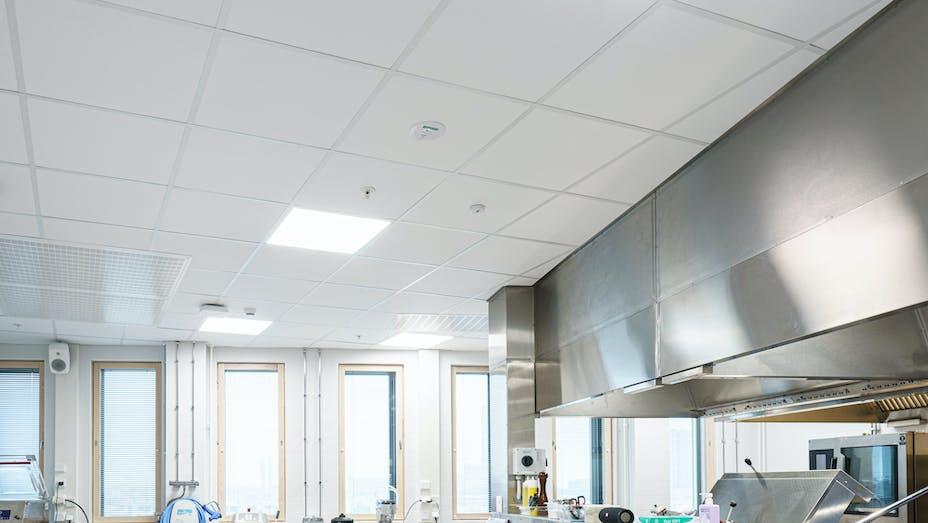 Kitchen in office Wood City in Helsinki Finland with Rockfon Hygienic in A-edge