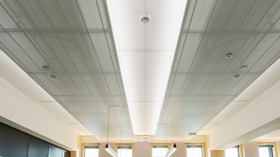 Open plan office in office Wood City in Helsinki Finland with Rockfon Blanka in As-edge