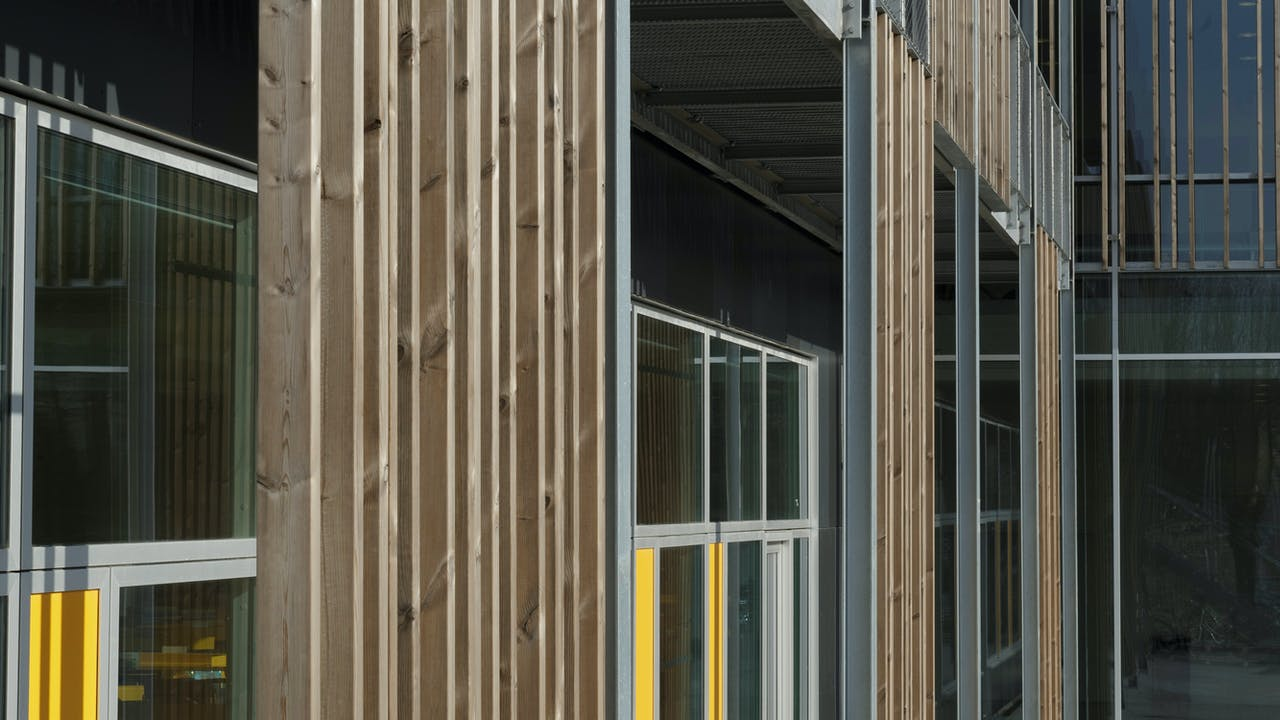Klostermarksskolen in Roskilde, Denmark cladded with Rockpanel Colours RAL 7016 and RAL 7021 facade cladding