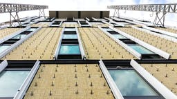 Hotel Breeze, cavity, ventilated facade, high rise building, PV panels
