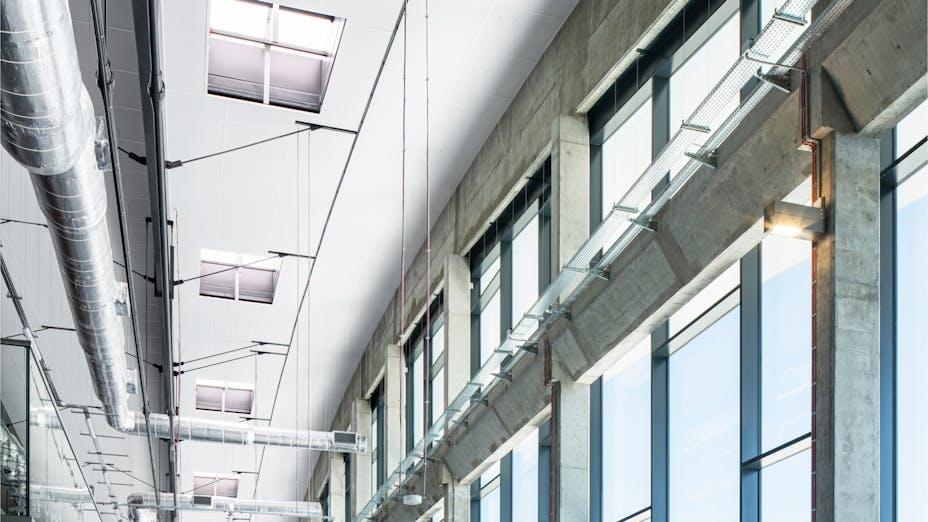 Corridor in Mosir sports centre in Puławy Poland with Rockfon Samson AEX-edge