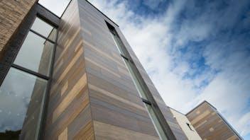 Multi family houses (Davidson's Mill) in Aberdeen, United Kingdom cladded with Rockpanel Woods Ebony Slate, Ebony Granite, Rhinestone Oak and Ceramic Oak facade cladding