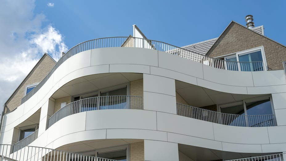 Multi Family housing in Ypres, Belgium cladded with Rockpanel Colours and curved.