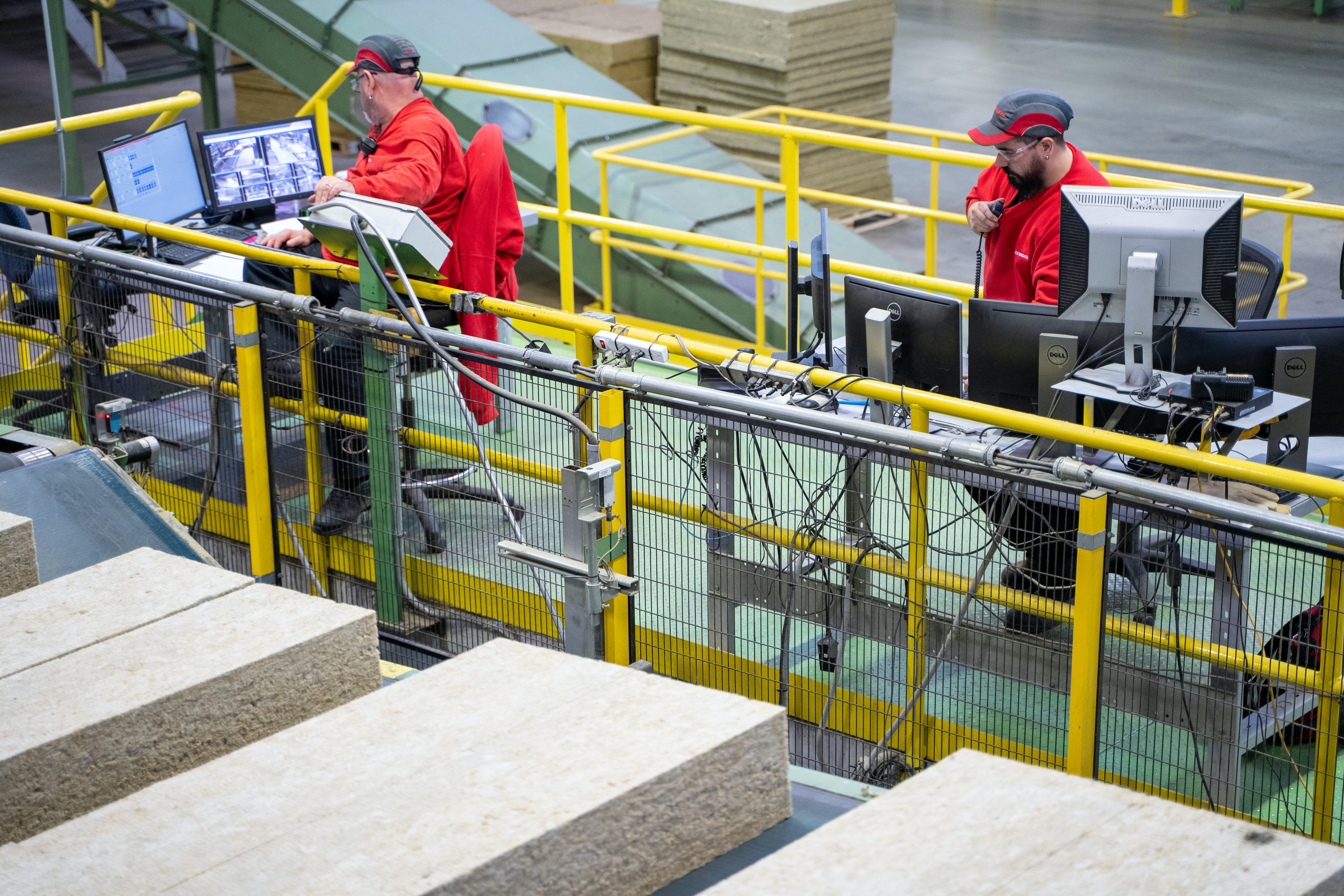 People working together, doing their jobs, teamwork, plant operations at the production manufacturing factory facility in Milton, ON