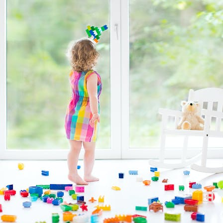 Child playing with blocks indoor