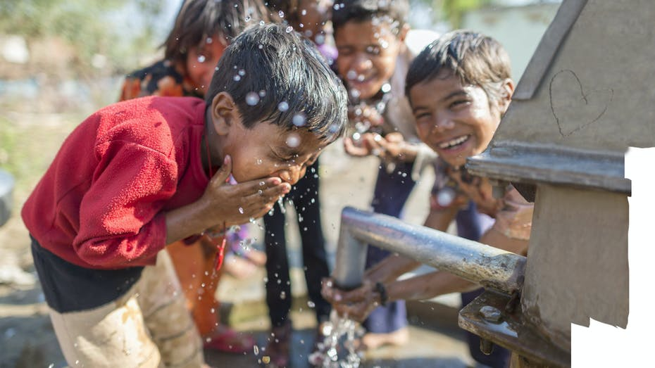 Young boys having fun at water well, GRODAN, our thinking