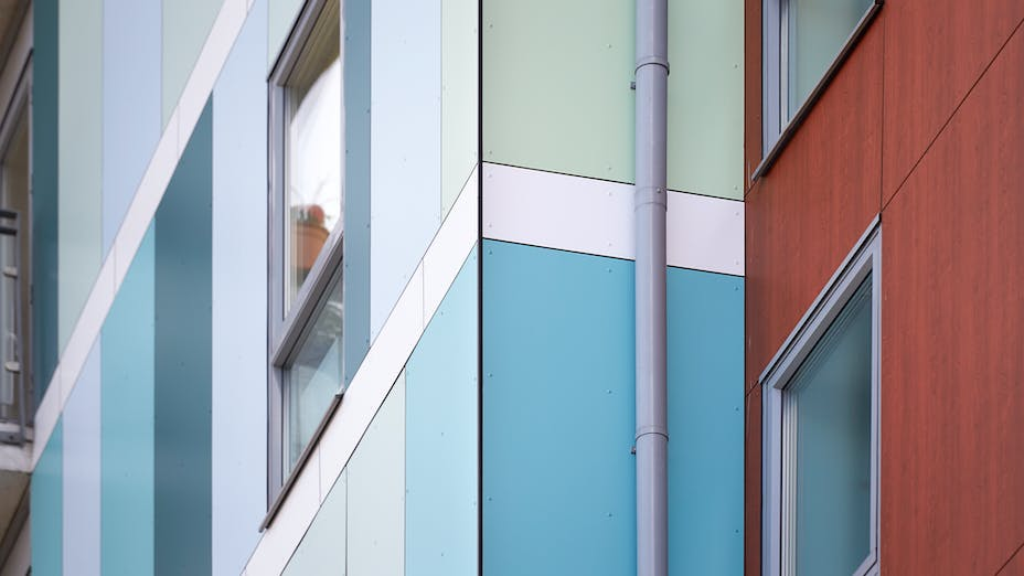 Eyot House (Multi Family House) in Bermondsey, London, United Kingdom cladded with A2 (FS-Xtra) in seven RAL colours plus Metallics Graphite Grey and Woods Cherry facade cladding.