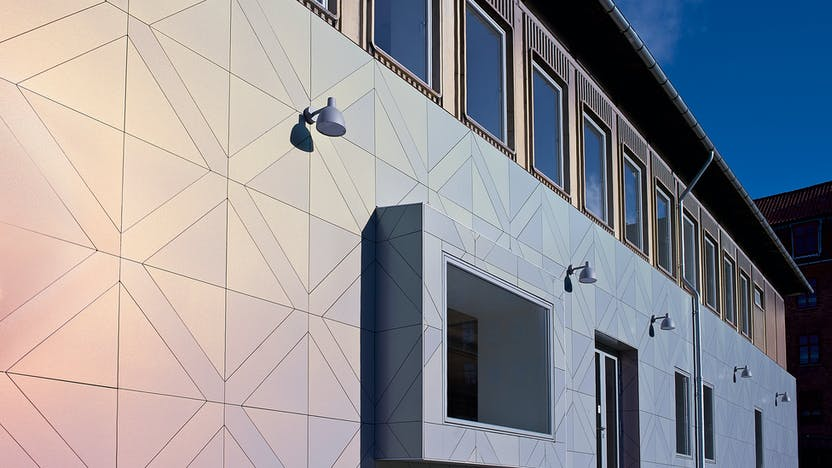 Kulturhuset Valhalsgade (Osramhuset) in Copenhagen, Denmark cladded with Rockpanel Chameleon facade cladding