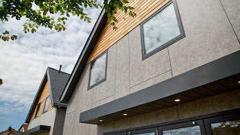 Single family houses in Tankerton, Whitstable, United Kingdom cladded with Rockpanel Stones facade cladding.