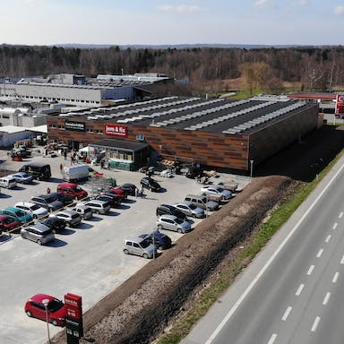 jem & fix store in Fredensborg, Denmark cladded with Rockpanel Woods facade cladding