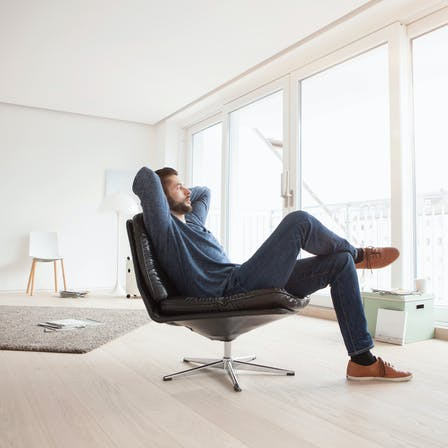 RockWorld imagery,The Big Picture, people, indoors, chair, recliner, man looking out window, carpet, apartment, flat