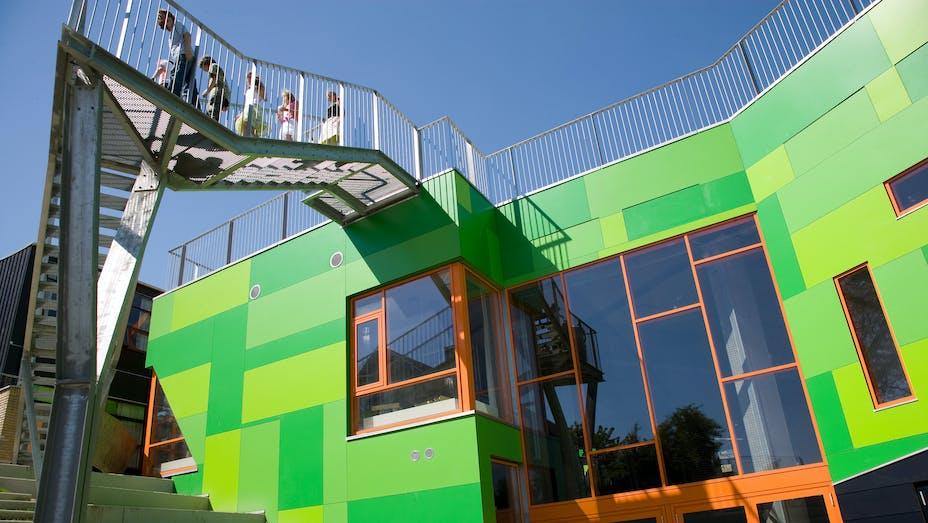 Bakkegårdskolen in Gentofte, Denmark cladded with Rockpanel Colours RAL 120 70 75, RAL 130 60 60, RAL 140 50 60, RAL 5004 facade cladding