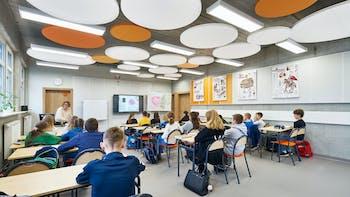 PL, Poznan, Marcin Sakson, Front Architects, Education, Rockfon Eclipse, Rockfon Samson, circle, 600x600 white, orange