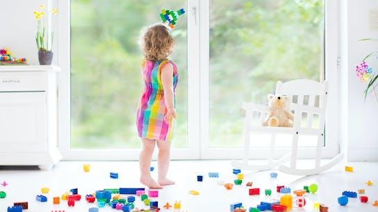 Child playing with plastic bricks