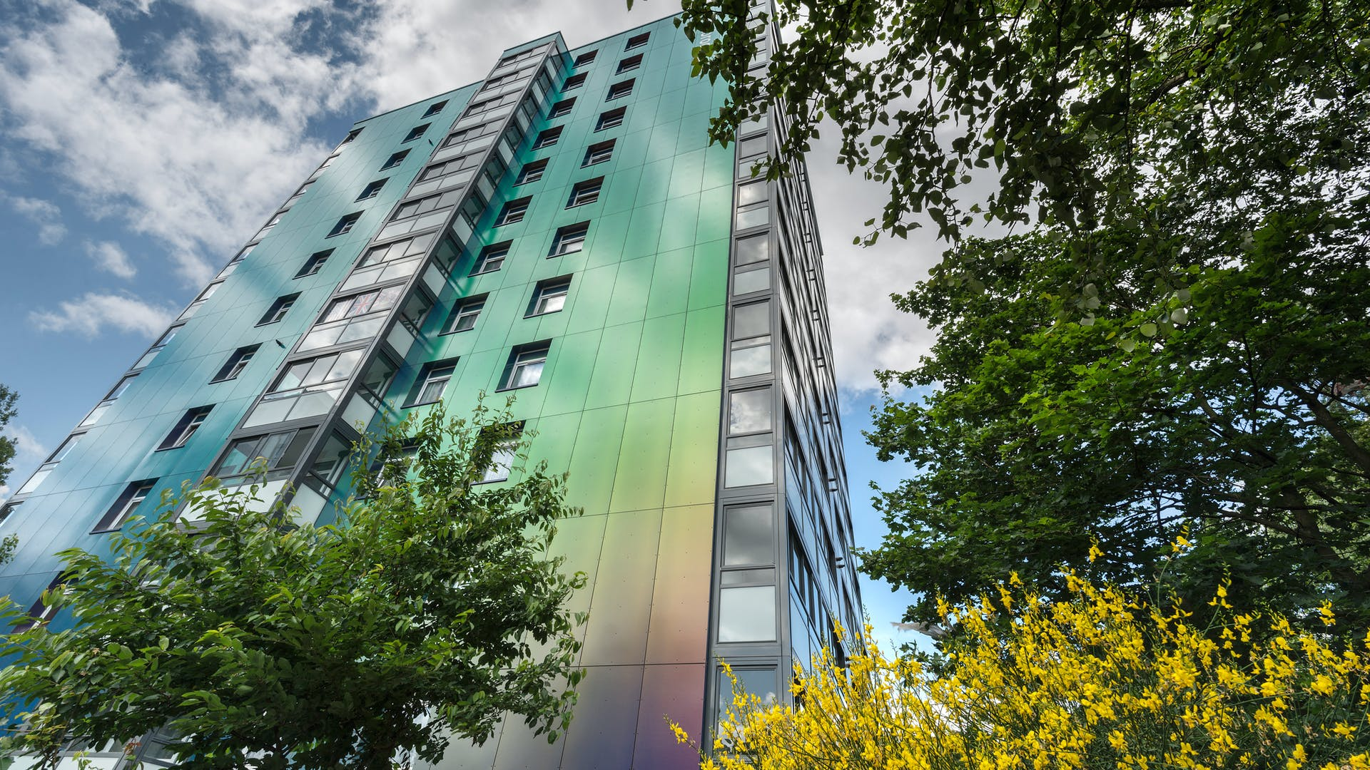 Renovation of 4 tower blocks in Manchester (Untied Kingdom) with Rockpanel Chameleon External Cladding