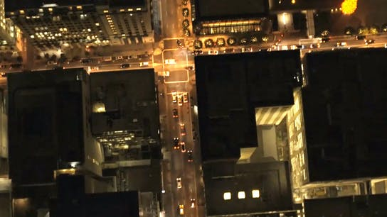 Multifix-Rooftop-Image (1), helicopter view, city, night, street lights, buildings, high rise