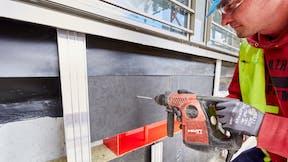 drilling machine, facade, fleece laminated, craftsman, installer, HafenCity Hamburg, germany