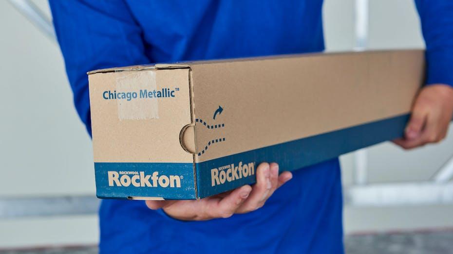 suspension grids, packaging, man carrying carton, chicago metallic