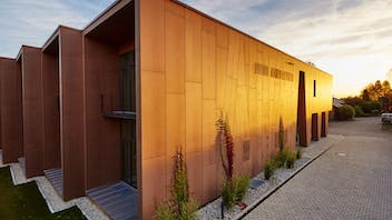 Offices and factory of the Brunner family business in Eggenfelden, Germany with Rockpanel Natural exterior cladding