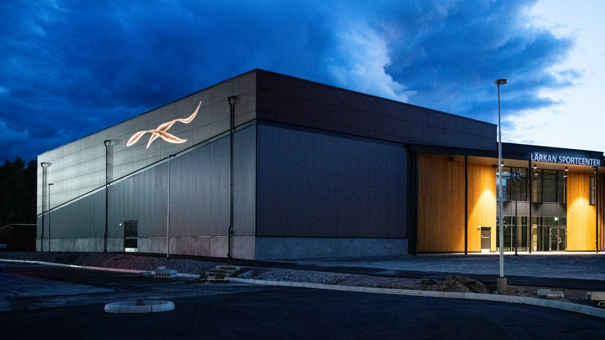 Sports hall 'Lärkan' in Sala, Sweden cladded with Rockpanel Stones Mineral Rust and Basalt Iron facade cladding.