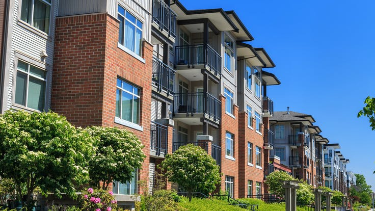 Modern apartment buildings sustainable urban development and building construction practices in the United States.