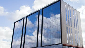 A modern office building in Krakow, Poland with Rockpanel Woods exterior cladding