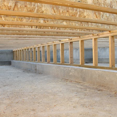 Construction Site: Neat Clean Crawlspace, Floor Joists, and Pony Wall - crawl space design and installation process