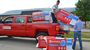 ROCKWOOL bags on truck getting offloaded in Grand Forks