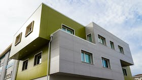Primary school in Ancona, Italy cladded with Rockpanel Colours RAL 095 50 50 and Woods Marble Oak facade cladding
