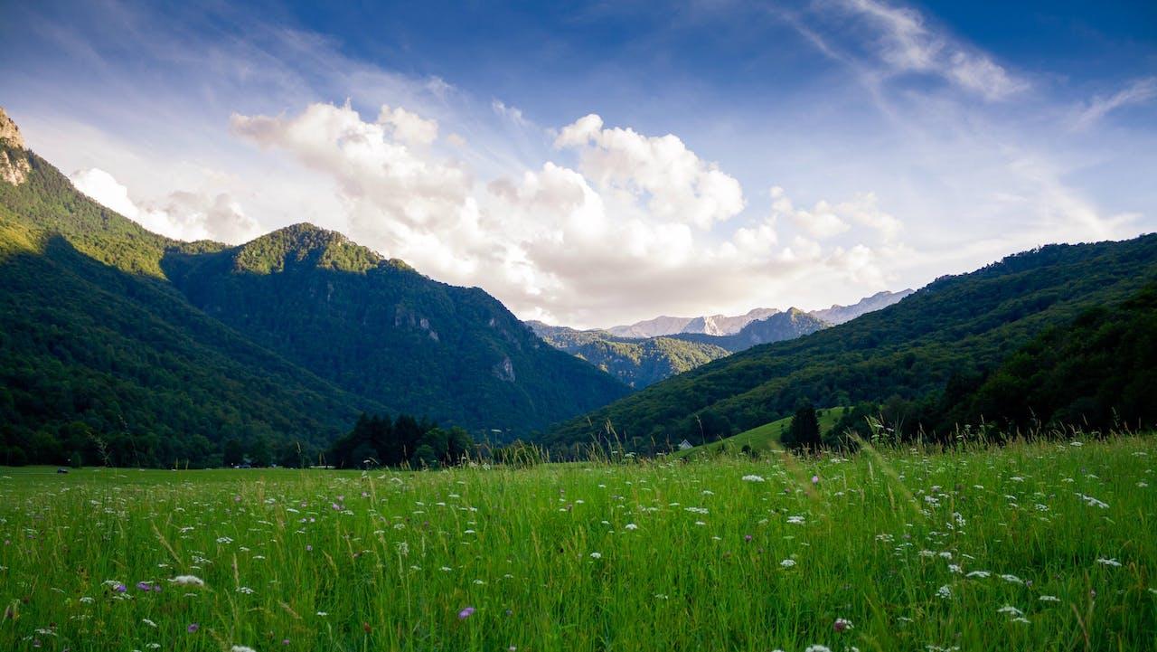 Unsplash image, photo by Nikola Majksner, landscape, mountains, green mountain sides, nature, skies, valley, grassy field