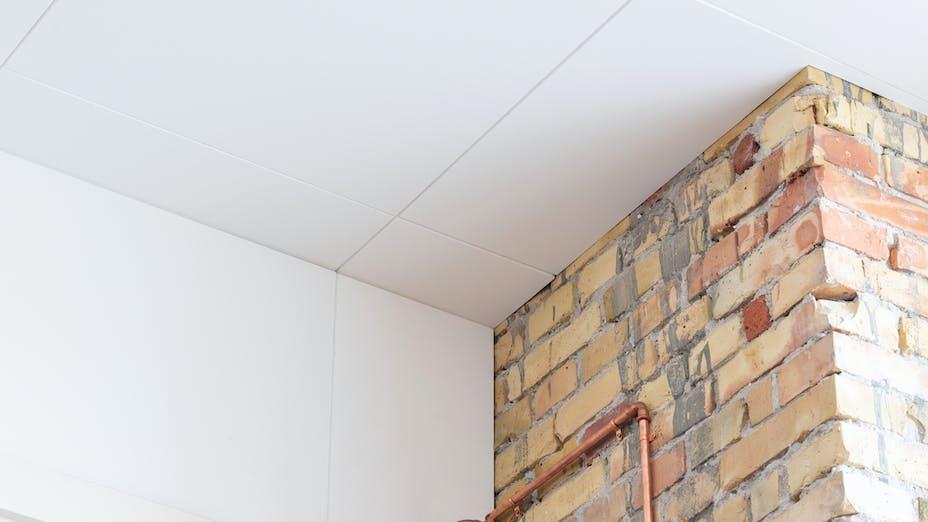 Close-up of ceiling in Hotel Villa Copenhagen Denmark with Rockfon Blanka tiles.