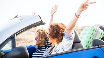 Couple adult women in convertible