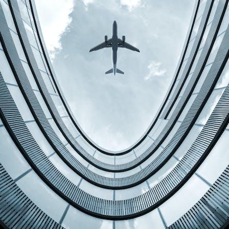 airplane, airport, building, sky