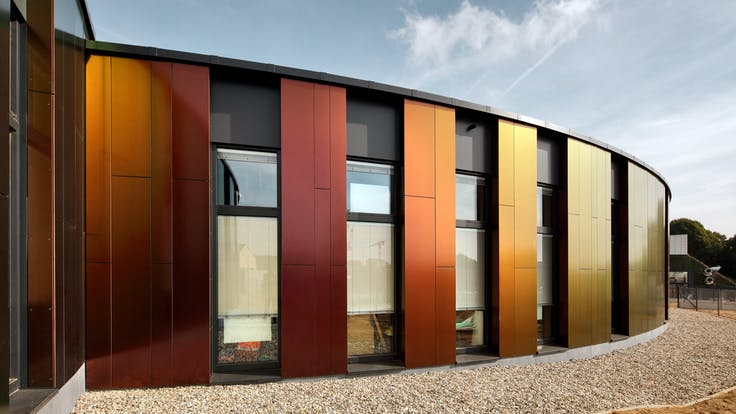 New build of the Les Trèfles primary school in Anderlecht, Belgium with Rockpanel Natural & Rockpanel Chameleon exterior cladding. Les Trefles