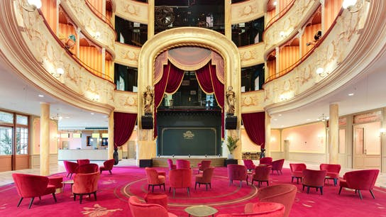 Auditorium and Lobby of Plopsa hotel in De Panne Belgium with Rockfon Color-all Stucco in D-edge