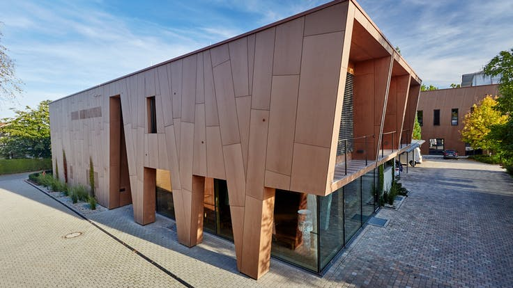 Office/production building with Rockpanel Natural facade cladding in Eggenfelden, Germany.