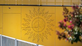 Rockpanel Metals Case Study Plein Solei Metallics Gold & Colour RAL 7012 with engraving and perforation