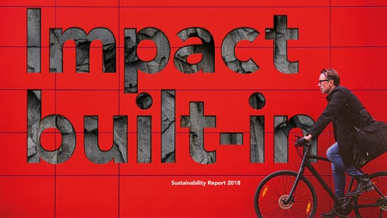 WILL BE DELETED  (safety issues) Man riding a bicycle in front of a red wall. Used for Sustainability Report 2018.