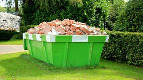 Container filled with construction waste