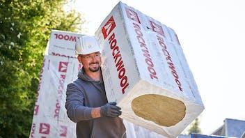 insulation slabs, dämmplatten, hero image, construction side, germany, fixrock, happy man carrying stone wool, fixrock