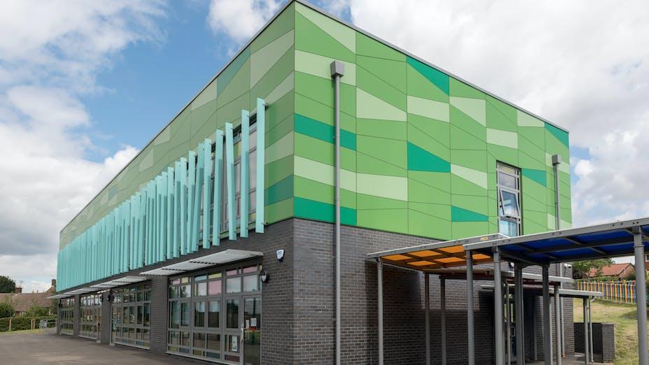 HERO Case Study UK Belswains School Rockpanel Colours Rockpanel Colours RAL 6029, RAL 6017, RAL D 1107077, RAL D 110 70 20