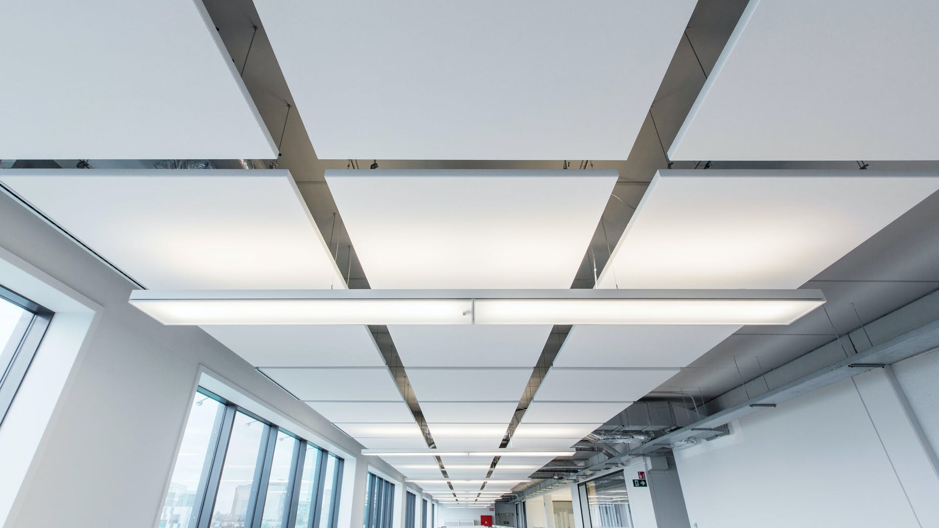 Frameless acoustic ceiling island (ceiling cloud) with Rockfon Eclipse (excellent sound absorption, high light reflection & light diffusion)