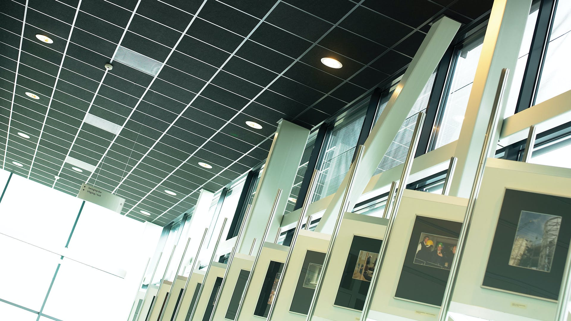 Acoustic ceiling with Rockfon Industrial Black ceiling tiles (Black finish, highest sound absorption, fast installation)