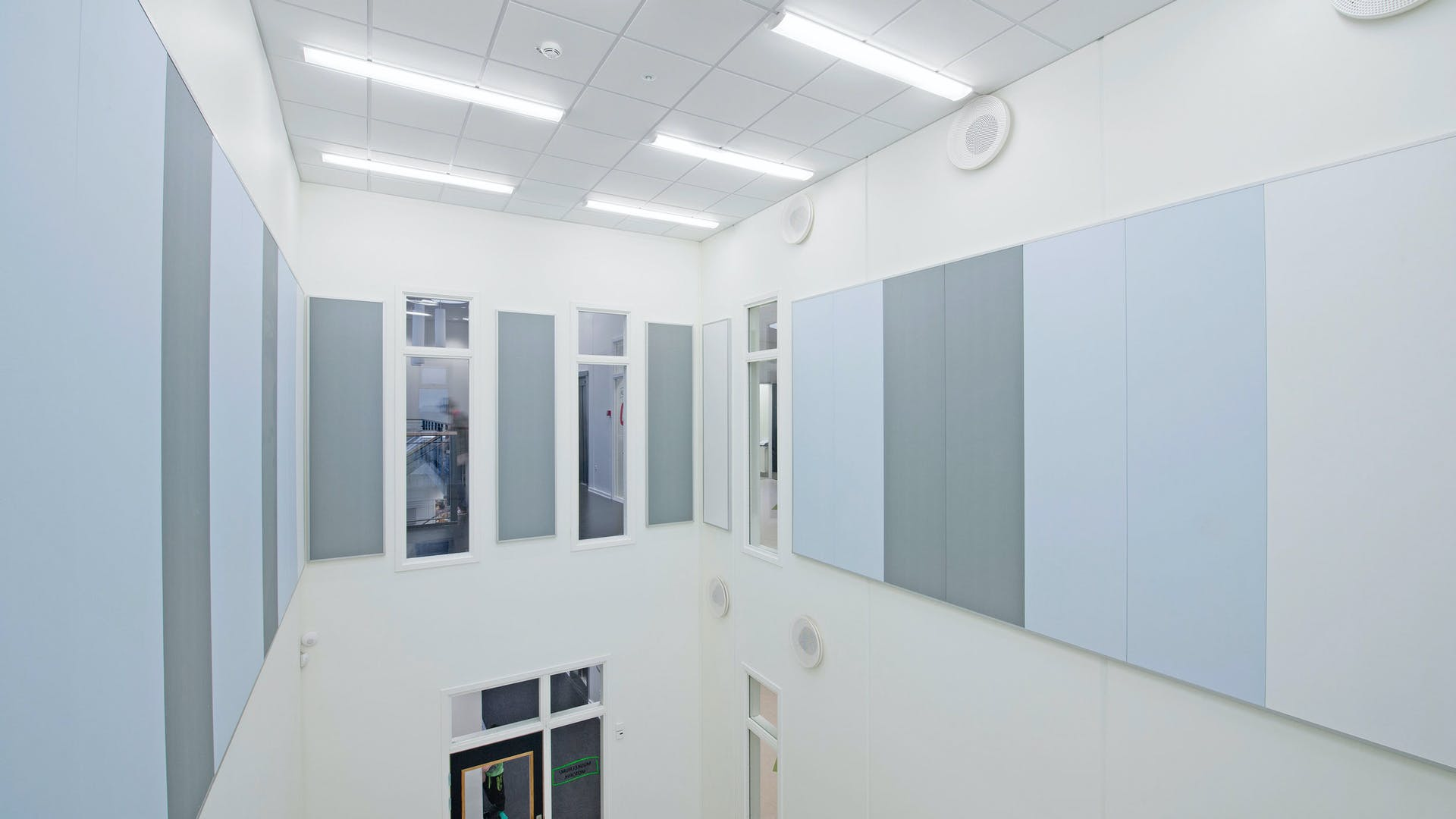 Highly sound absorbing acoustic wall panels with Rockfon VertiQ wall panel